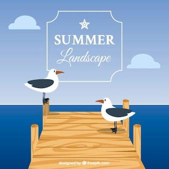 Achtergrond van de zomer met meeuwen op de pier