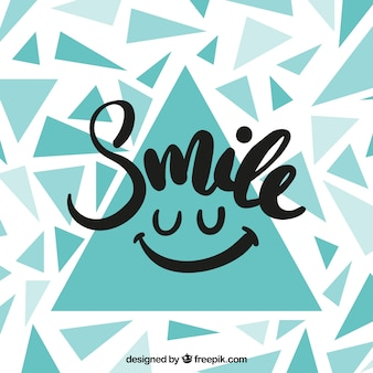 Achtergrond van driehoeken met het woord 'glimlach'