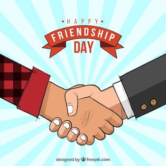 Achtergrond van gelukkige dag van vriendschap met handen