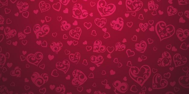 Achtergrond van grote en kleine harten met ornament van krullen, in karmozijnrode kleuren