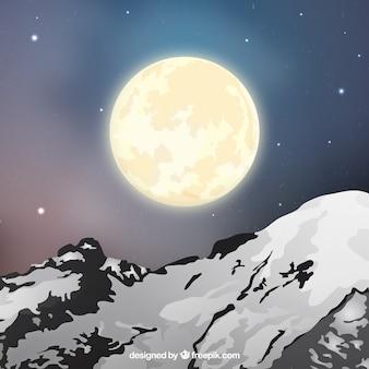 Achtergrond van het landschap met besneeuwde bergen en de maan