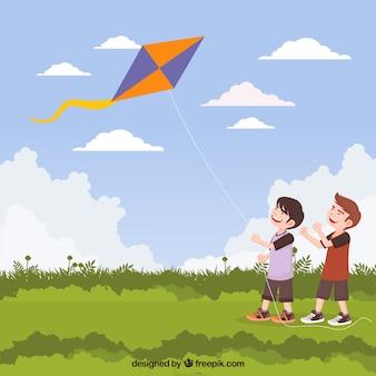 Achtergrond van kinderen met een vlieger in het veld