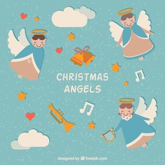 Achtergrond van mooie kerst engelen en muziekinstrumenten