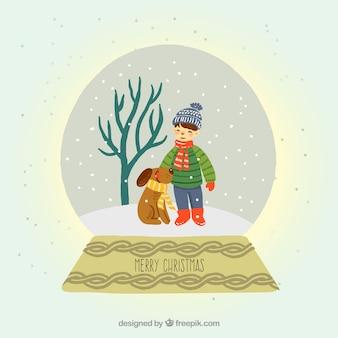 Achtergrond van sneeuwklokje van een kind en zijn hond