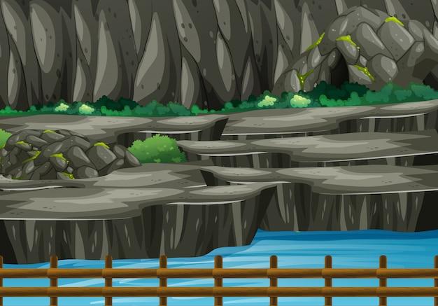 Achtergrondscène van park met grot en rivier