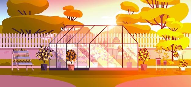 Achtertuin beplanting kas glazen oranjerie botanische tuin met bloemen en potplanten horizontaal