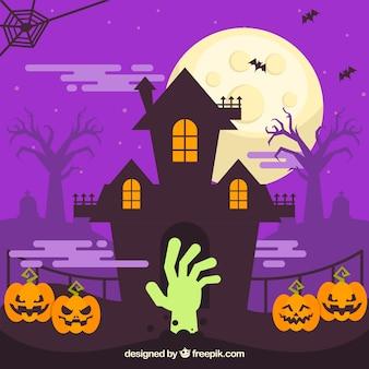 Achtervolgde huisachtergrond met pompoenen en zombiehand