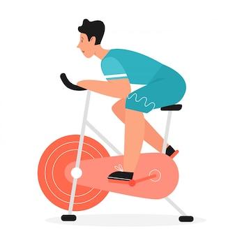 Actieve man rijdt op hometrainer fiets plat. fiets jong mannetje die spinnende sportactiviteiten, huisfitness doen gezond levensstijlconcept
