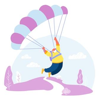 Actieve senior man skydiver sportactiviteit hobby gepensioneerde m / v drijvend in de lucht met parachute.