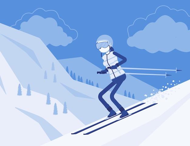 Actieve sportieve vrouw die bergafwaarts skiet, geniet van winterplezier in de buitenlucht op resort met prachtig besneeuwd uitzicht op de natuur, professioneel wintertoerisme, recreatie