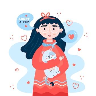 Adopteer een meisje dat een kitten vasthoudt