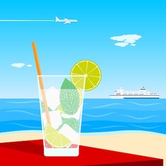 Afbeelding van een cocktail staande op tafel voor zee