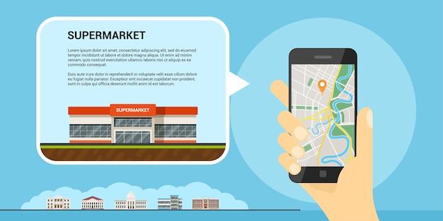 Afbeelding van een menselijke hand die een mobiele telefoon met kaart en gps-aanwijzer vasthoudt, is het concept van het scherm, mobiele kaarten en gps-positionering