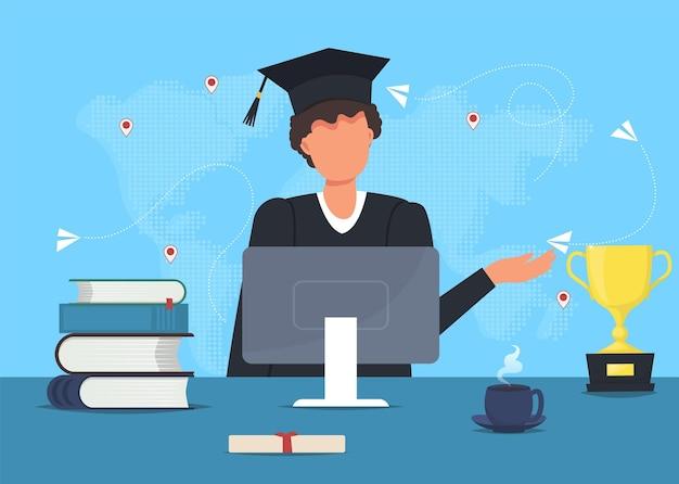 Afgestudeerde student in mantel met computer en boeken.