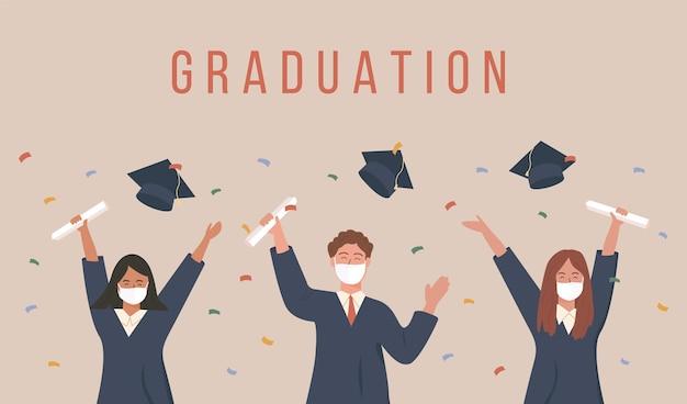 Afgestudeerde studenten gooien een pet op en vieren universitair afstuderen