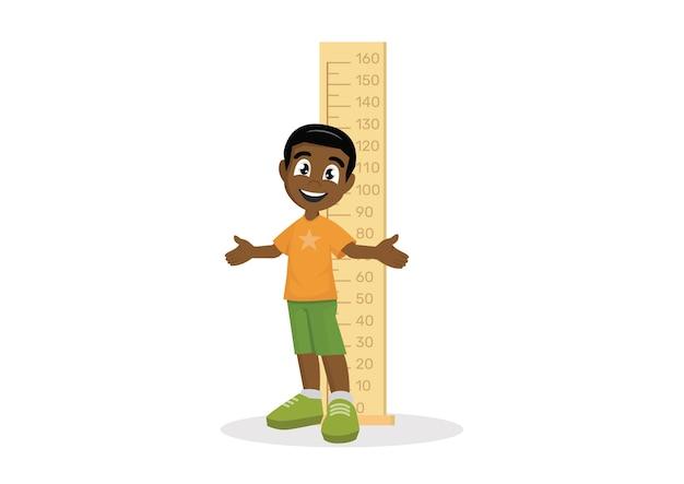 Afrikaanse jongen die hoogte meet.