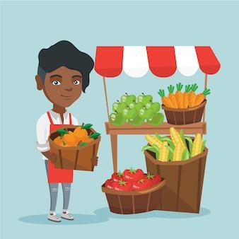 Afrikaanse straatverkoper met groenten en fruit