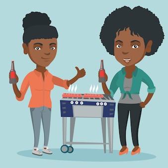 Afrikaanse vrienden plezier op barbecue feestje.
