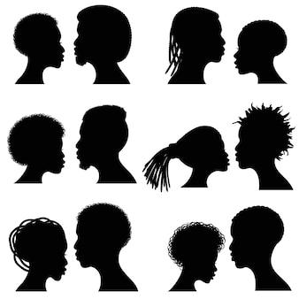 Afrikaanse vrouwelijke en mannelijke gezichts vectorsilhouetten