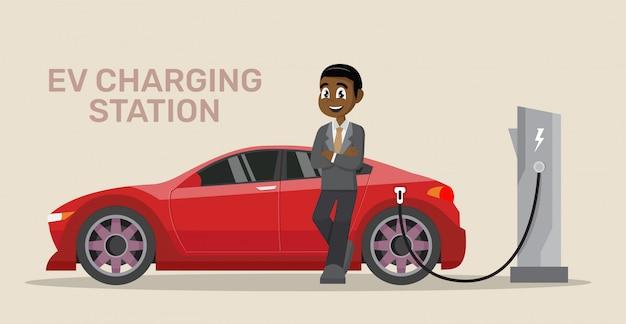 Afrikaanse zakenman elektrische auto opladen.