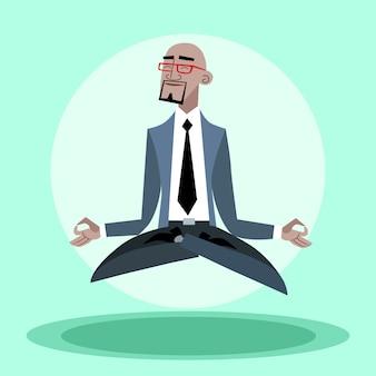 Afrikaanse zakenman hangt stil in de lucht als een yogi
