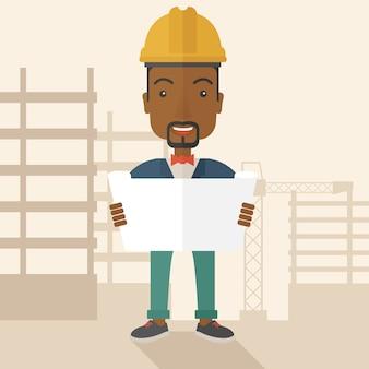 Afro-amerikaanse bouwvakker die het plan houdt.