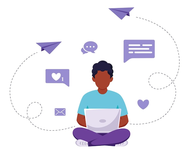 Afro-amerikaanse man zit met laptop