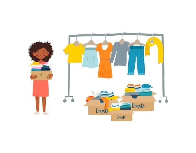 Afro-amerikaanse vrouw met kleren voor donatie