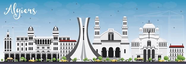 Algiers skyline met grijs gebouwen en blauwe hemel.