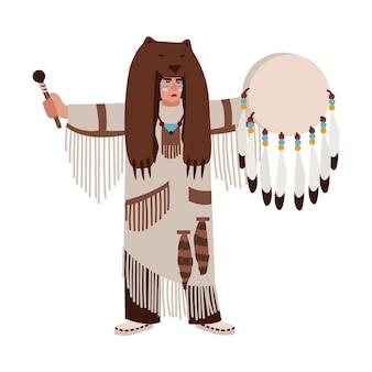 Amerikaanse indiaan met berenvel en etnische kleding die op zijn trommel slaat en geesten roept. sjamaanpriester of medicijnman die een religieuze ceremonie uitvoert. vectorillustratie in platte cartoonstijl. Premium Vector