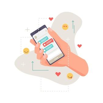 Applicatie smartphone in de hand online communicatie chat met likes en emoticon smileys geïsoleerd