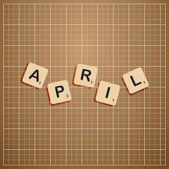 April maand in hoofdletters met scabbles blok concept