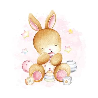 Aquarel baby konijn en speelgoed