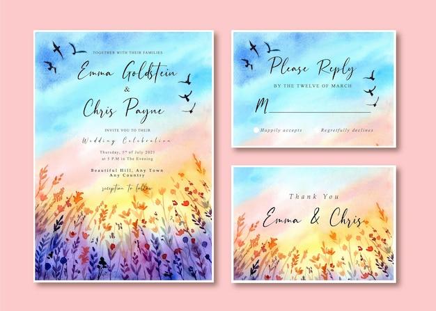 Aquarel bruiloft uitnodigingskaart met zonsondergang landschap en vogels