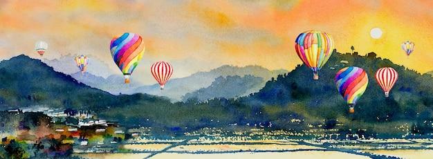 Aquarel landschap schilderij kleurrijk van hete luchtballon, berg en korenveld in het panoramische uitzicht en emotie landelijke samenleving, natuur lente op hemelachtergrond. abstracte verfillustratie in azië.
