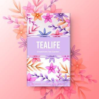 Aquarel thee ontwerp met bloemen in roze tinten