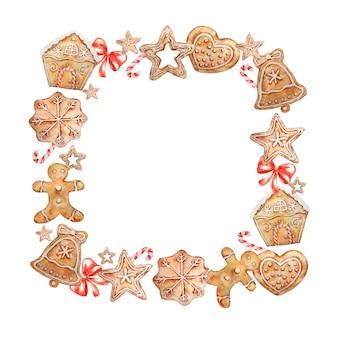 Aquarel vierkante kerstkrans met peperkoekkoekjes, snoepjes en rode strik.