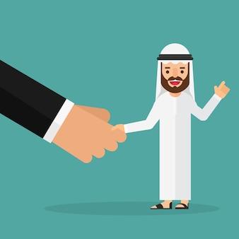 Arabische bedrijfsmens die grote handen schudden