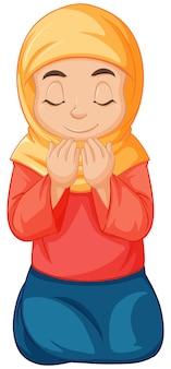 Arabische moslim meisje in traditionele kleding in bidden positie geïsoleerd op een witte achtergrond