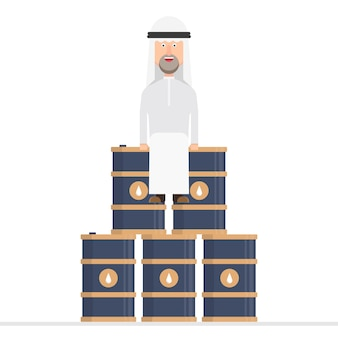 Arabische zakenman zit op olievaten
