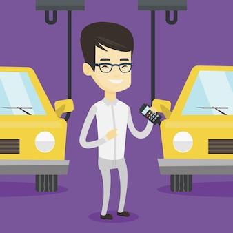 Arbeider die geautomatiseerde assemblagelijn voor auto controleert
