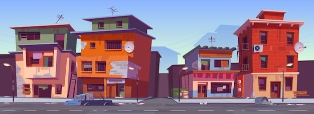 Arme vuile huizen in het getto-gebied. vector cartoon stadsgezicht met sloppenwijken gebouwen, hutten in goedkope buurt. sloppenwijkstraat met oude huizen, kapotte auto en afval