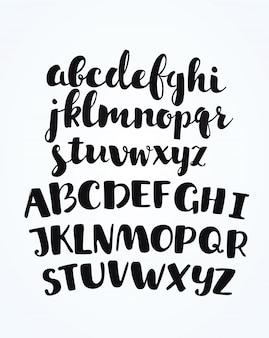 Artistieke handgetekende gouden lettertype. alle letters zijn geschilderd in gouden textuur. cursief, vetgedrukt. illustratie.