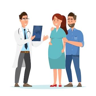 Arts die echografieblad toont aan zwangere vrouw en haar echtgenoot bij het ziekenhuis.