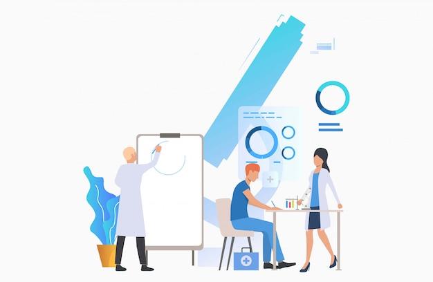 Artsen die grafiek trekken en met buizen werken