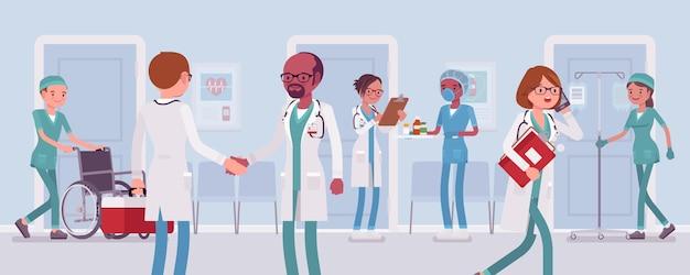 Artsen en verpleegsters die in een ziekenhuis werken