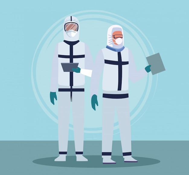 Artsenpersoneel dat medische biohazard draagt, past bij apparatuur