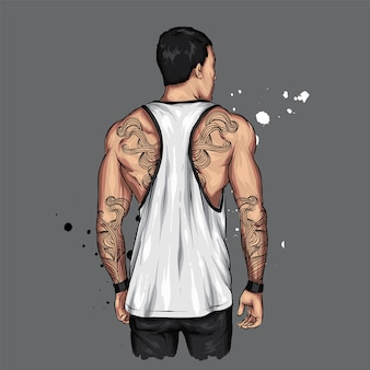 Atletische man in een t-shirt en met tatoeages.