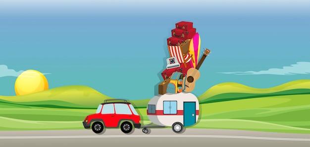 Auto en wagen vol koffers op de weg