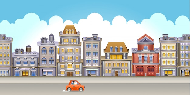 Auto gaat door een weg met hoge gebouwen
